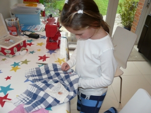 C sewing on button